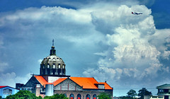 Above All... (Vic de Vera) Tags: city sky church clouds landscape photo heaven philippines chapel steeple explore cannon airlines oldest philippine tallest cubism spaniards augustinian pasigcity artisticexpression aboveall goldstaraward vicdevera staclarademontefalcoparishchurch