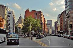 the road less traveled. new york, new york. (johnblack!) Tags: nyc newyorkcity sunshine clouds soho blueskies citystreets johnblack tallbuildin