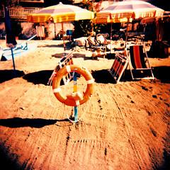 Sunlight in my hair (Ilaria ♠) Tags: 6x6 mediumformat holga xpro mare crossprocess liguria toycamera lsd ombrelloni spiaggia sdraio cogoleto medioformato toycamerafotografiaanalogicaitalia fujisensiaii100ra solemarecoccobello felliniinacido