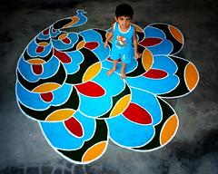 patmish and the kolam (mkannan) Tags: boy diwali hindu kolam