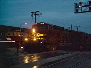 Eastbound BNSF Railway freight train entering Berwyn Illinois at twilight. March 2007.