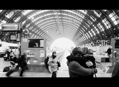 Love... (Luca Morlok) Tags: travel bw italy milan travelling love station start train canon hug kiss italia sweet milano rail railway trains powershot railwaystation baci passion iloveyou goodbye lovely 13 embrace truelove stazione lombardia treno amore viaggio malinconia tenderness bacio centralst