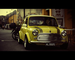 Another Piece of History (Yellow Mini) (Fadzly @ Shutterhack) Tags: china street travel vacation orange holiday hot history nature car yellow austin d50 asian town interestingness nikon asia bokeh antique chinese culture photojournalism documentary mini rover malaysia tropical tropic restoration kuala morris kampung minor cina relics asean terengganu equator dorp humid 50mmf14ai aldeia mys   aldea automobil   maleisi    explored   nikonstunninggallery  shutterhack  nikon50mmf14ai