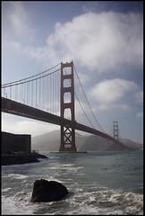 Golden Gate Bridge from Fort Point (rickz) Tags: ocean sf sanfrancisco california ca bridge beach rock fog waves pacific foggy wave pacificocean goldengatebridge goldengate fortpoint aplusphoto