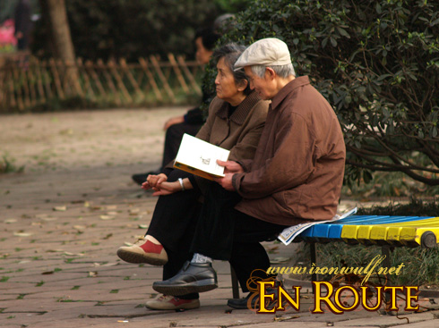 Lovely Old Couple reading a book