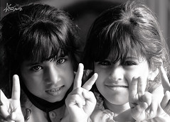 "138\365     a letter we carry, we are Middle East children and peace for ALL (""Anwaar) Tags: girls bw white black love beautiful smile smiling kids canon out pretty day peace sad sweet days them 365 feeling kuwait q8 138 dema jod sadfeeling 400d"