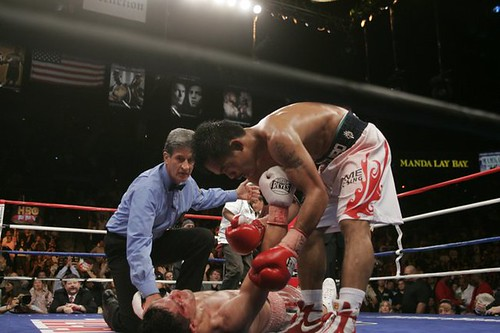 Manny Pacquiao helps David Diaz