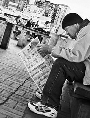 Reading the funnies (El Gregein) Tags: seattle street bw white black blancoynegro newspaper pix market pikeplacemarket pike victorsteinbrueckpark seattlest seattlestpix