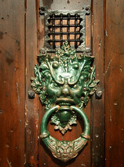 Needful Things - Door Knocker (Dominic's pics) Tags: door film brighton gothic kitsch spooky starbucks novel mansion stephenking eastsussex addamsfamily kemptown stevenking antiquefurniture unlicensed planningpermission stjamessstreet needfulthings artbusiness localcouncil starbucksprotest brightonandhovecitycouncil stjamessstreet