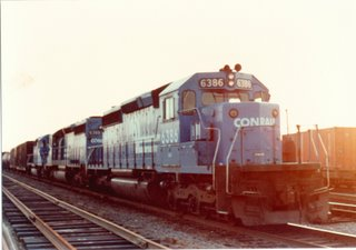 Eastbound Conrail freight train at sunset in the Burlington Northern RR Clyde Yard. Cicero Illinois. June 1983.