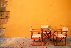 Spanish Yellow (Roy Cheung Photography) Tags: orange yellow horizontal wall closeup table outdoors cafe spain chair day image sale empty nopeople images catalonia spanish brickwall getty gettyimages absence gettyimage sidewalkcafe traveldestinations colorimage supershot eyelevel mywinners geronaprovince colourartaward artlegacy nikonflickraward