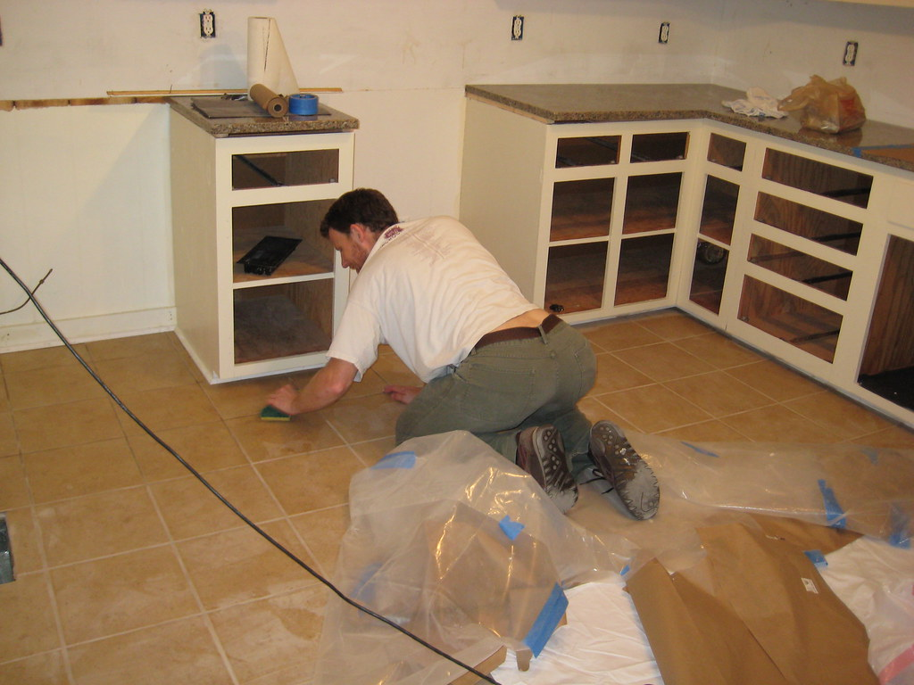 Me cleaning the tile floor