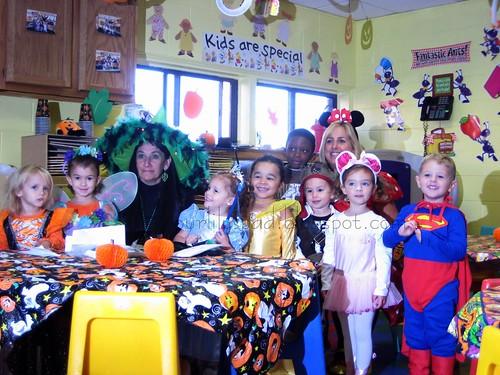 her preschool class in their Halloween costumes