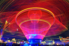 Turning fast and faster!... (Tambako the Jaguar) Tags: longexposure blue light red abstract night switzerland nikon ride wideangle carousel fair basel explore hero winner 12mm fest d300 impressedbeauty colourartaward herowinner