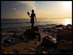 Moment of Zen (Sator Arepo) Tags: sunset sea beach backlight landscape book evening reflex rocks olympus calm karate shore zen flare balance karatekid polarizer lowkey seashore zuiko e500 uro 1454mm retofz090210 gettyimagesiberiaq2