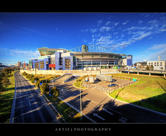 Telstra Dome, Melbourne :: HDR (:: Artie | Photography ::) Tags: road shadow cloud building architecture modern photoshop canon highway cs2 stadium australia melbourne wideangle funky victoria structure age telstra dome handheld 1020mm hdr artie telstradome dockland 3xp sigmalens photomatix tonemapping tonemap 400d rebelxti