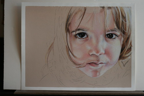 Photo of in progress colored pencil portrait of my daughter.