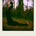 Natalie doing yoga on a dead tree thumbnail