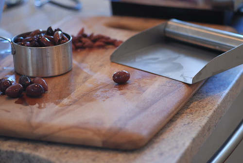 pastry scrapers help pit olives