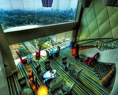 The Top Floor in Kuala Lumpur (Stuck in Customs) Tags: windows light panorama house colors lines architecture modern breakfast club composition work photography design cool intense nikon shoot photographer shot floor angle chairs image photos unique background interior details d2x decoration perspective picture hilton best exotic edge malaysia tables processing vip vista pro kualalumpur framing portfolio capture decor interiordesign hdr treatment bellisima mostviewed highquality clubfloor stuckincustoms treyratcliff