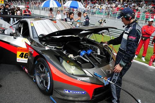 Technician checking a race car (Nikon 18-200mm VR sample photos taken at the Super GT 2008 race, Sepang)