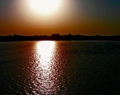 Amber Hues - On Explore! (sir_watkyn) Tags: sky sun india water reflections river landscape interestingness scenery perfect photographer dusk silhouettes hues varanasi picnik ganges the fiatlux abigfave platinumphoto aplusphoto ysplix damniwishidtakenthat sirwatkyn