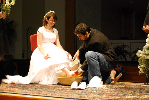 Nathan washes Sarah's feet