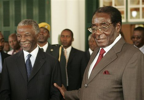 Former South African President Thabo Mbeki along with Zimbabwe President Robert Mugabe. The two leaders are working on a power-sharing agreement for Zimbabwe. by Pan-African News Wire File Photos