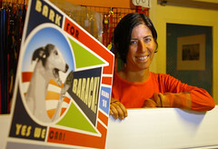 Metro Dog co-owner Diane Livoti with Bark for Barack poster (Photo by Kristopher Skinner/Contra Costa Times)