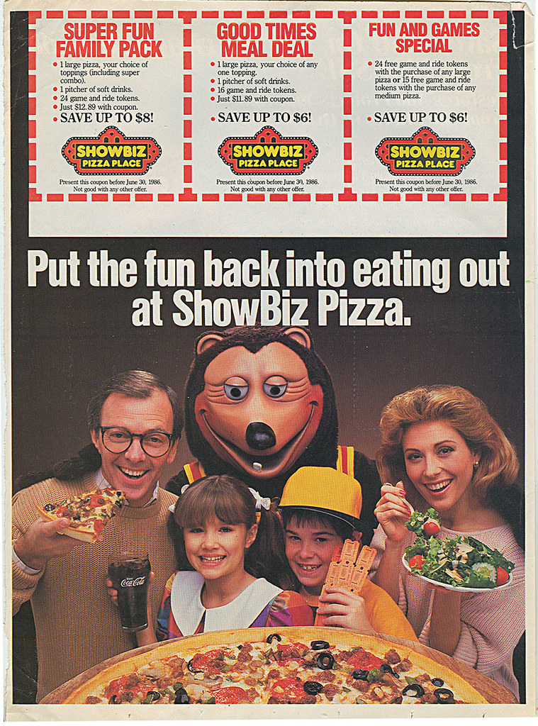 """""""Put the fun back into eating out at ShowBiz Pizza."""" Sunday Coupon Circular (( 1986 ))"""