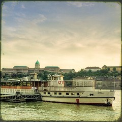 Oldie, but goldie (PhatCamper) Tags: light sunset building castles texture water architecture vintage buildings river boats boat interestingness flickr hungary cityscape budapest naturallight textures cruiseship duna filters ungarn textured attila donau hungarian irfanview tourboat magyarorszg flickrites dunav reinvented szchenyilnchd 500x500 ttv pseudohdr dunapart vintagefeel haj nesster olympuse410 donauradwanderweg singlerawtonemapped budapestaward textra texturesquared phatcamper