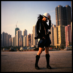 J (Lefty Jor) Tags: camera light shadow hk 120 6x6 film girl hat buildings hair t hongkong stand day photographer dof wind kodak hasselblad misu planar 500cm carlzeiss 80mmf28 ektacolorpro160