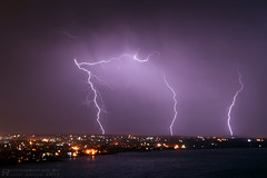 Things to do at home 4:00am ... chasing lightening (R.Azhari) Tags: light sea sky night canon coast syria lightening mediterranian lattakia eos500d canon18200mm t1i