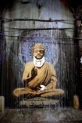 Banksy's beaten up Buddha