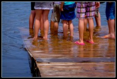 sink the dock! (unonymous) Tags: summer lake feet water kids children outdoors dock cottage dragonboat
