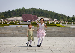 Do not talk to strangers - North Korea (Eric Lafforgue) Tags: pictures travel boy woman girl cemetery female children asian photo kid women war asia child femme picture korea kimjongil asie martyrs revolutionary enfant fille journalist journalists northkorea pyongyang  dprk chilren  coreadelnorte juche kimilsung nordkorea 8731 lafforgue   ericlafforgue   coredunord coreadelnord  northcorea canoneos1dsmarkiii coreedunord rdpc  insidenorthkorea  rpdc revolutionarymartyrscemetery   demokratischevolksrepublik coriadonorte  kimjongun coreiadonorte