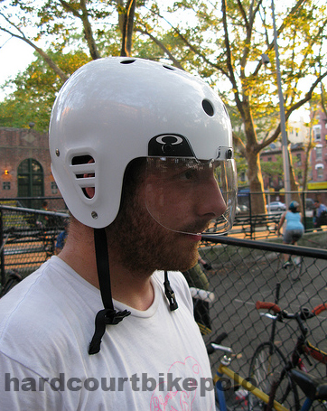 Paul with bike polo face guard helmet