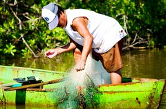 Hard Work (Je Rpondrai) Tags: wood trip travel lake man green net water canon mexico boat fisherman rustic lagoon acapulco fisher 5d guerrero manglar barravieja 70mm200mm