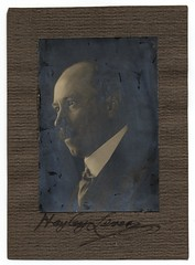 Hayley Lever (Smithsonian Institution) Tags: man black art face glare african bald tie suit autograph mustache collar hayley lever smithsonianinstitution signedphoto archivesofamericanart  blackandwhiteprofileofhayleylever widepaperframe hayleyleverphoto