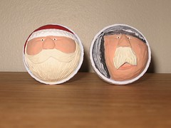 Carved golf ball caricatures