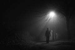 A Man, In a night, under sunlight... (HAMED MASOUMI) Tags: light bw sun man fog night canon manchester alone iran sigma rays iranian hamed 30d 11pm   1850mm hamedmasoumi  maosumi  behindmyflat
