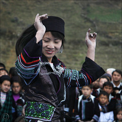 Monday Indigo Blues -- Hmong dancer over clapping Bamboo (NaPix -- (Time out)) Tags: new blue portrait woman festival dance buffalo dancing outdoor embroidery year indigo games dancer bamboo ox vietnam celebration explore lunar journalism sap