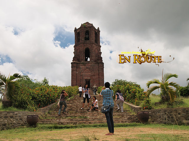 A group of tourist being touristy at Bantay Tower