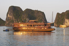Golden Twilight Halong Bay (trickyd3) Tags: sea reflections golden boat twilight vietnam serene halongbay