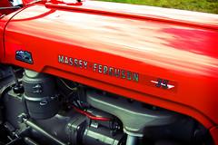 It's a Massey Ferguson 35 tractor (©Komatoes) Tags: red tractor lens lomo nikon kitlens devon exeter kit 35 ferguson massey veryred masseyferguson d40 masseyfergusontractor didisayitwasred redmasseyferguson