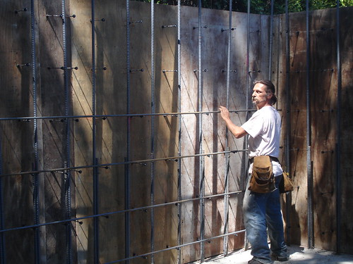 kim tying in rebar for the shop walls