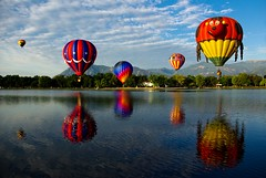 reflecting color (zyrcster) Tags: sky reflection clouds balloons coloradosprings hotairballoons memorialpark coloradoballoonclassic photofaceoffwinner photofaceoffplatinum pfogold pfohiddengem oct08pfobrackets bigpictr