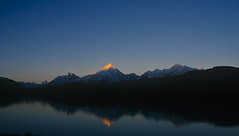 The first ray of light on CB 14, Chandertal lake, Spiti (sapru) Tags: blue sky mountain lake reflection sunrise trek landscape dawn still cool fantastic quiet peace horizon lakes relaxing restful calming surreal floating peaceful tranquility calm silence harmony serenity serene dreamlike hush stillness tranquil himachal himalayas balanced poised spiti gentle daybreak soothing calmness pradesh treks quietness comforting composed otherworldly illusory unruffled chandertal untroubled unperturbed lahaul chandrataal lahual unworried flickrelite firstrays trancelike unlimitedphotos lakesinhimachal treksinhimachal