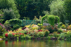 Monet Garden (linda yvonne) Tags: reflection pond kansascity arbor kansas benches overlandpark overlandparkarboretum gardenaccents interestingness42 i500 monetgarden favoritegarden overlandparkarboretumandbotanicalgarden colorharmonies gracefulbridge latesummersgoldsredsandgreens opabg