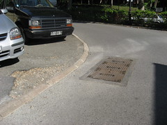 Possible hand hole spot, on left in front of silver car